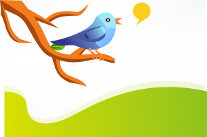 Image of a bird tweeting on a branch