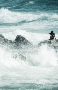 Image showing a woman alone amongst the waves