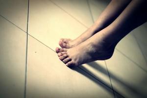 Image showing feet standing on tiptoe